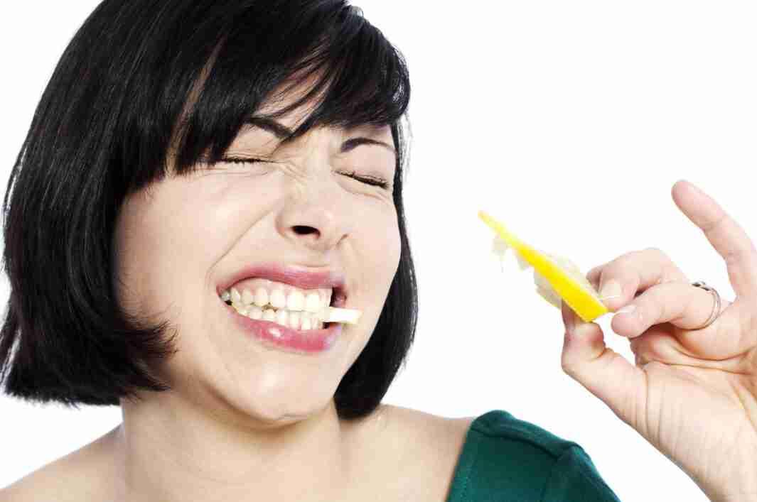 woman-biting-sour-lemon